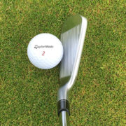 TaylorMade P790 iron and ball on grass