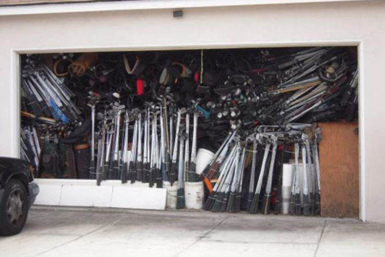 Cluttered garage with golf clubs gathering dust